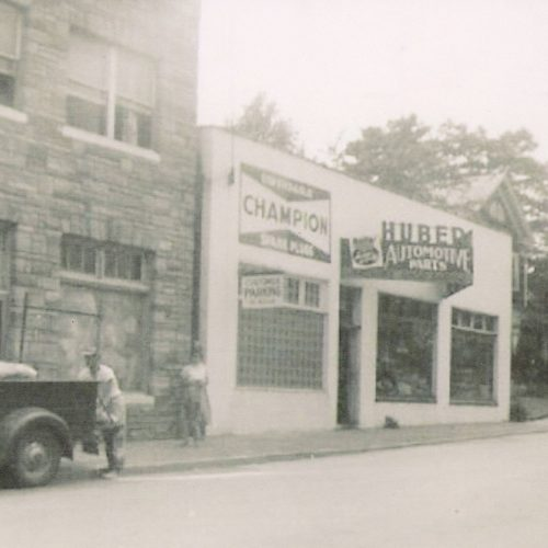 Building housed an automotive shop shown here in the 1930s